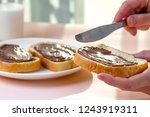 spread chocolate paste on... | Shutterstock . vector #1243919311