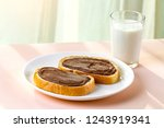 a pieces of loaf with spread... | Shutterstock . vector #1243919341
