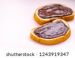 pieces of loaf with chocolate... | Shutterstock . vector #1243919347