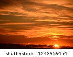 clouds at the spanish sky ... | Shutterstock . vector #1243956454