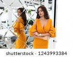 tender lady in yellow dress... | Shutterstock . vector #1243993384
