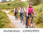 pre teen girl riding mountain... | Shutterstock . vector #1244019091