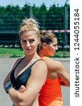 two young sportswomen posing... | Shutterstock . vector #1244055184