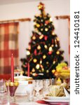christmas tree and laid table | Shutterstock . vector #124410181