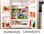open refrigerator filled with...   Shutterstock . vector #1244102371