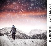 man in alps and winter time  | Shutterstock . vector #1244123074