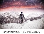 man in alps and winter time  | Shutterstock . vector #1244123077