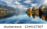 Beautiful Sunny day in Alps. wonderlust view of highland lake With autumn trees under sunlight and perfect sky. Landscape with Alps and Zeller See in Zell am See, Salzburger Land, Austria