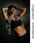 Young sports woman with heavy chain fashion portrait. - stock photo