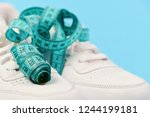 sneakers with measuring tape on ... | Shutterstock . vector #1244199181