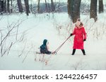 woman pulling sled with her... | Shutterstock . vector #1244226457