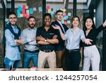 emotional team of diverse young ... | Shutterstock . vector #1244257054