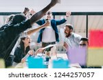 successful team of young people ... | Shutterstock . vector #1244257057