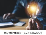 hand of male holding a light... | Shutterstock . vector #1244262004