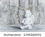 little guardian angel with... | Shutterstock . vector #1244360431