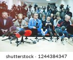 press conference. news... | Shutterstock . vector #1244384347