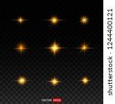 gold glitter bokeh lights and... | Shutterstock .eps vector #1244400121