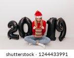 inspired blond girl in santa's... | Shutterstock . vector #1244433991