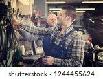 happy two men in coveralls... | Shutterstock . vector #1244455624