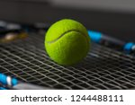 yellow tennis ball on a racket | Shutterstock . vector #1244488111