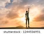 young female celebrating... | Shutterstock . vector #1244536951