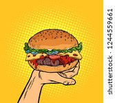 burger on hand. fast food. pop... | Shutterstock .eps vector #1244559661