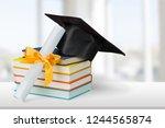 graduation mortarboard on top... | Shutterstock . vector #1244565874