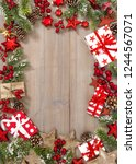 christmas tree branches  gifts... | Shutterstock . vector #1244567071