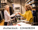 happy woman customer paying... | Shutterstock . vector #1244608204