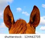 the horse's ears against the sky | Shutterstock . vector #124462735