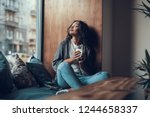 peaceful young lady sitting on... | Shutterstock . vector #1244658337