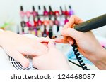 professional manicure in process | Shutterstock . vector #124468087