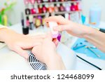 professional manicure in process | Shutterstock . vector #124468099