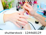 professional manicure in process | Shutterstock . vector #124468129
