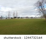 large lawn of public park with... | Shutterstock . vector #1244732164