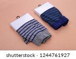 men boxer shorts on orange... | Shutterstock . vector #1244761927