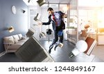 playing football in office.... | Shutterstock . vector #1244849167