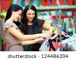 two smiling woman shopping in... | Shutterstock . vector #124486204