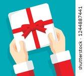 santa claus giving christmas... | Shutterstock .eps vector #1244887441