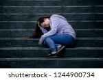 young sad and depressed asian... | Shutterstock . vector #1244900734