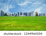 green field with high building... | Shutterstock . vector #1244964334