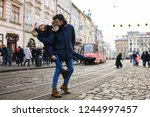 a trendy young couple walks in... | Shutterstock . vector #1244997457