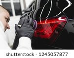 car detailing   worker with... | Shutterstock . vector #1245057877