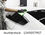 a man cleaning car with... | Shutterstock . vector #1245057907