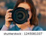 a camera with a big lens and a... | Shutterstock . vector #1245081337