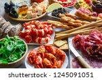 italian antipasti snacks set.... | Shutterstock . vector #1245091051