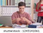 teenage boy doing homework at... | Shutterstock . vector #1245141061