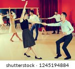 young smiling people practicing ... | Shutterstock . vector #1245194884