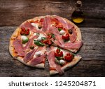 real italian pizza with... | Shutterstock . vector #1245204871