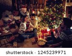 group of happy friends sitting... | Shutterstock . vector #1245239971